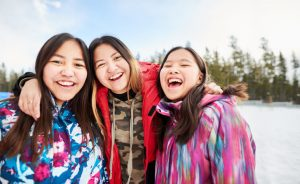 Three indigenous girls representing Ignite Faith Niagara truth, reconciliation, and Indigenous ministry