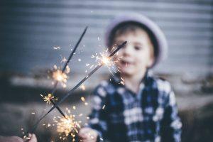Ignite Faith Niagara young boy lighting a sparkler.