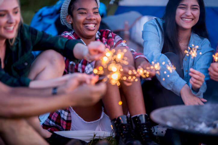 Young people with sparklers near camp fire representing Ignite Faith Niagara Canterbury Hills Camp