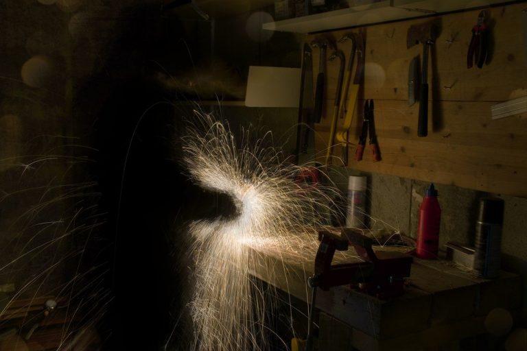Ignite Faith Niagara man working on lathe in workshop sparks flying