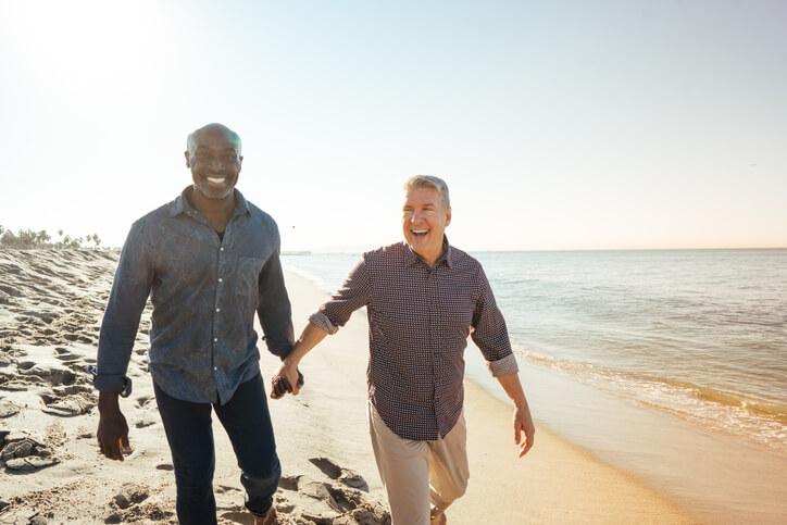 Two men on beach representing Planned Giving Ignite Faith Niagara